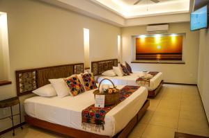 Cama o camas de una habitación en Casa Azul Maya
