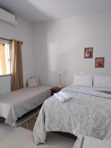 Cama o camas de una habitación en Suites do Ratinho