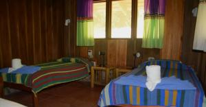 A bed or beds in a room at Esquinas Rainforest Lodge