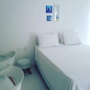 A bed or beds in a room at Mar Turquesa Eco Pousada