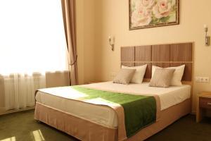 Кровать или кровати в номере Отель Медовая