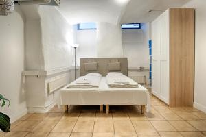 A bed or beds in a room at Lodge32 HOSTEL