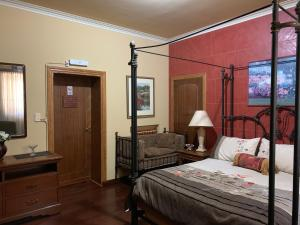 A bed or beds in a room at Quinta Ugarte