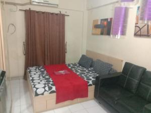 A bed or beds in a room at ZetPro Room