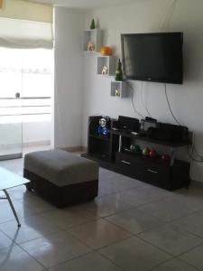 A television and/or entertainment centre at Asia departamento de playa