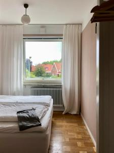 Säng eller sängar i ett rum på HEMMET Simrishamns vandrarhem och B&B