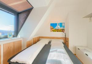 Ein Bett oder Betten in einem Zimmer der Unterkunft Hostel-Marburg-one