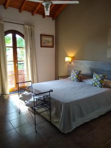 Una cama o camas en una habitación de Hotel Tunuyan
