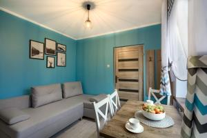 A seating area at Apartamenty u Romana