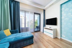 Телевизор и/или развлекательный центр в Аппартаменты на Курортном Проспекте 105