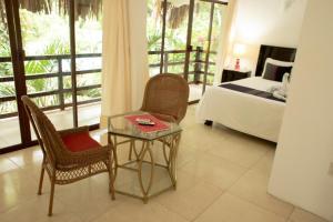 Een zitgedeelte bij Hotel la Aldea del Halach Huinic