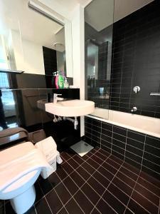 A bathroom at Readyset Apartments at Liberty