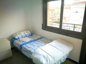 A bed or beds in a room at House with 3 bedrooms in Esparreguera with wonderful city view balcony and WiFi