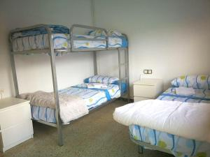 A bunk bed or bunk beds in a room at House with 3 bedrooms in Esparreguera with wonderful city view balcony and WiFi