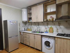 A kitchen or kitchenette at Akaki's Guesthouse