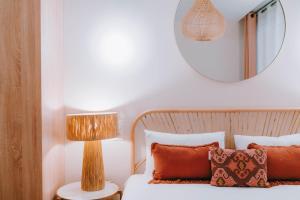 Un ou plusieurs lits dans un hébergement de l'établissement Appart' Rennes BnB - Centre Gare