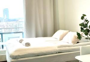 A bed or beds in a room at City Home Finland Tampella - City View, Own Sauna and Great Location