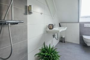 Ein Badezimmer in der Unterkunft Aparthotel Pumpengasse
