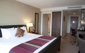 A bed or beds in a room at Staybridge Suites London- Stratford, an IHG Hotel