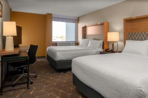 A bed or beds in a room at Holiday Inn Boston - Dedham Hotel & Conference Center, an IHG hotel