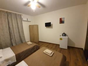 Postel nebo postele na pokoji v ubytování City Center Athenes rooms