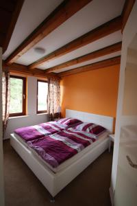 A bed or beds in a room at Armarova Ihre Ferienpension