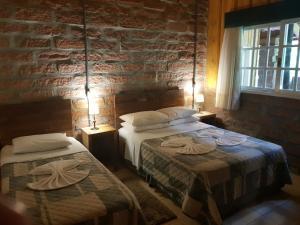 A bed or beds in a room at Stillo Gramado Bella Itália