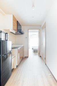 A kitchen or kitchenette at Doutonbori Crystal Exe