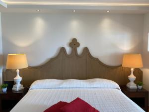 A bed or beds in a room at Studio Orient Bay