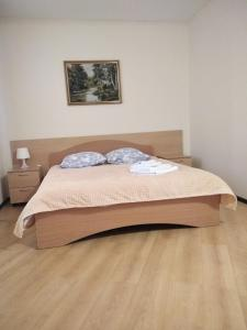 A bed or beds in a room at ЕВРАЗИЯ