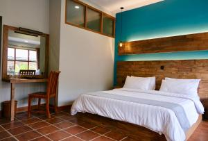 A bed or beds in a room at Trawangan Dive Resort