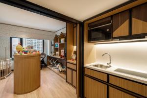 A kitchen or kitchenette at Shangri-La Hotel Harbin