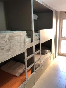 A bunk bed or bunk beds in a room at Hostel One Sants