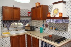 Cucina o angolo cottura di Casevacanza Soleluna