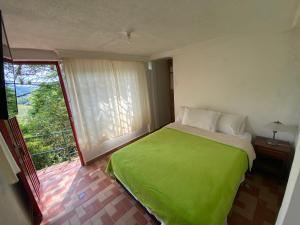 Łóżko lub łóżka w pokoju w obiekcie Eco Lodge La Juanita