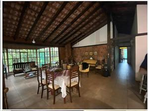 A restaurant or other place to eat at Room in Spacious Nature Cottage