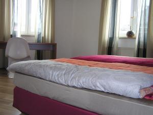 Ein Bett oder Betten in einem Zimmer der Unterkunft Auerbachs Keller
