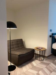 A seating area at ROXI Residence Gent