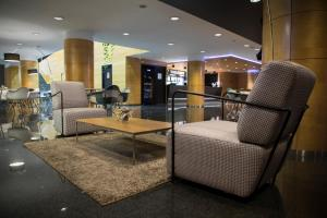 The lobby or reception area at Golden Tulip Andorra Fenix
