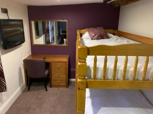 A bunk bed or bunk beds in a room at Best Western Plus Sheffield Mosborough Hall Hotel