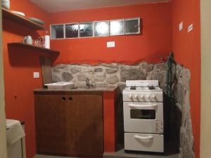 Una cocina o kitchenette en La Morada Aparts & Suites