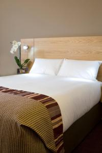 A bed or beds in a room at Jurys Inn Derby