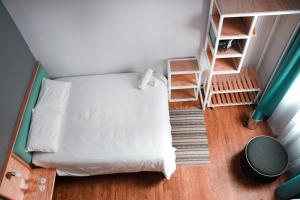 A bed or beds in a room at Casa Pepe