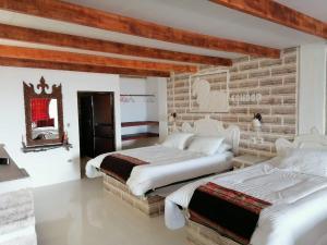 Uma cama ou camas num quarto em Casa de Sal - Salt Hotel