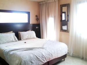 A bed or beds in a room at Apartment with 2 bedrooms in Marrakech with shared pool furnished terrace and WiFi 185 km from the beach