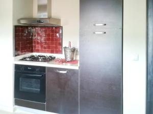 A kitchen or kitchenette at Apartment with 2 bedrooms in Marrakech with shared pool furnished terrace and WiFi 185 km from the beach