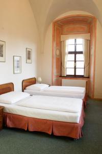 아달버트 에코호텔 객실 침대