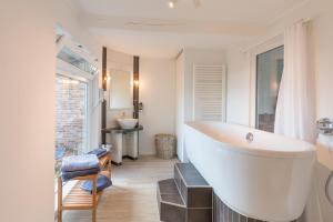 Ein Badezimmer in der Unterkunft Reethus Backbord Dagebüll