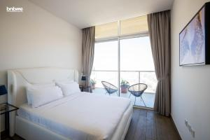 A bed or beds in a room at 4B-Hameni-1092E by bnbmehomes