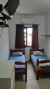 Cama ou camas em um quarto em Pousada Nova Opção